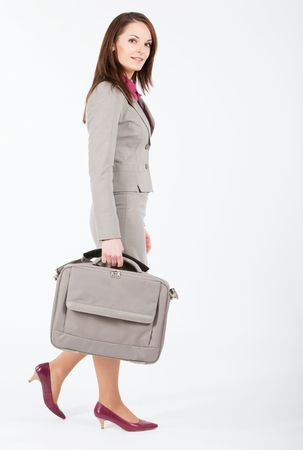 business woman walking with computer case in right hand photo