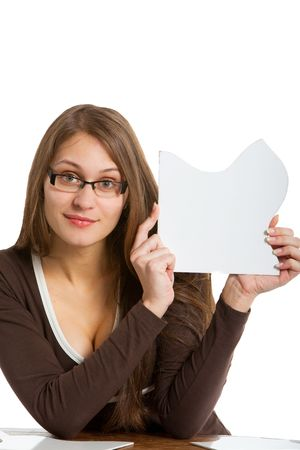 woman holding one big white puzzle card close to her face