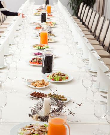 long served restaurant table with snacks and salads