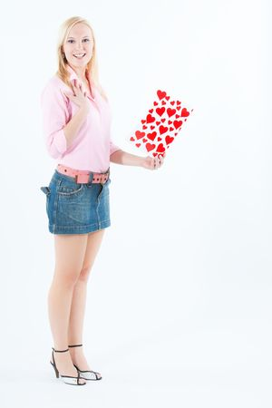 young adult blond woman holding big valentine postcard, looking happy photo