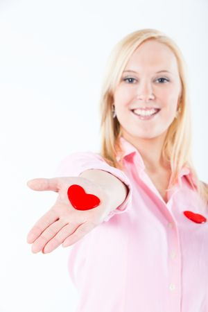 young adult blond woman exposing heart shapes in her palms
