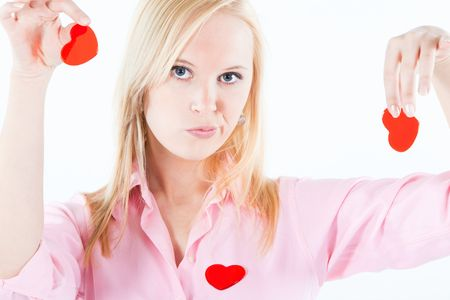 disappointed': young adult blond woman holding heart shapes in her hands with finger tips, looking disappointed