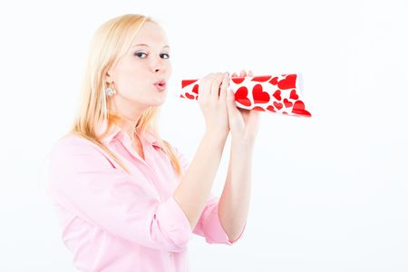 young adult blond woman blowing a love trumpe covered with hearts photo
