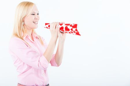 young adult blond woman shouting with love trumpe covered with hearts Stock Photo