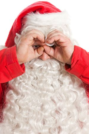 funny Santa Claus looking through hands binocular photo