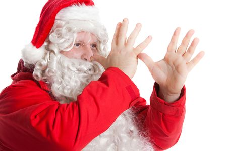 funny Santa Claus showing long nose with two hands Stock Photo