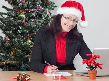 business woman making a christmas present wish list