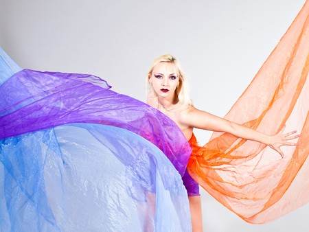 beautiful young woman with colorful fabric, horizontal shot photo