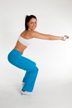 young woman exercising thrust, vertical side view