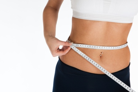 woman measuring waist size with meter, horizontal Stock Photo