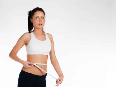 Frau Bundweite mit Meter, horizontale messen