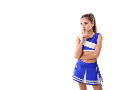 Young cheerleader in blue and white suit on white background. Isolated on white background.