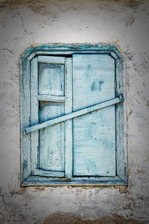 Vintage background from fragment of an old adobe wall with wooden blue window. Stok Fotoğraf