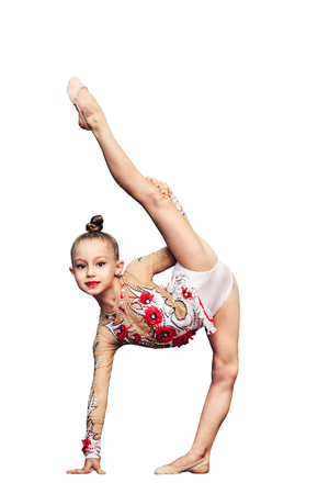 Little girl is engaged in rhythmic gymnastics isolated on white