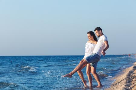 boy and girl fun splashing on the sea Stock fotó