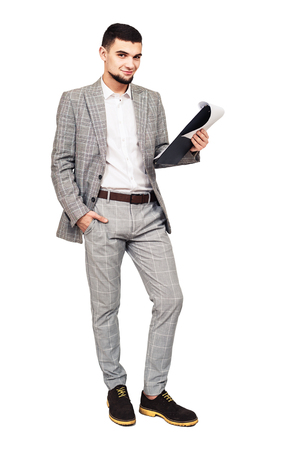 Preparing for the performance. young stylish guy in a gray suit with a tablet in his hand. isolated on white Stock fotó