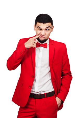the guy has something stuck in his teeth. funny man in a red suit shows a finger in his mouth. isolated on white 免版税图像