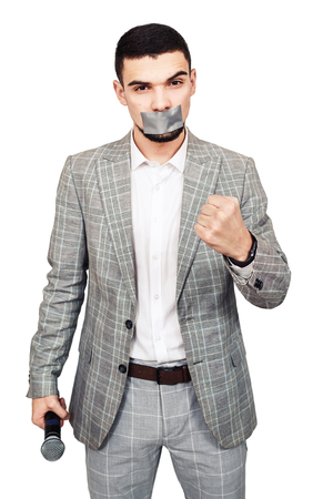 violation of freedom of speech, dictatorship. male journalist with mouth sealed. isolated on white
