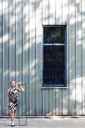 Beautiful teen girl holding broken glass in her hands. The concept of complex adolescence