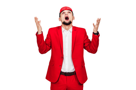 young businessman relies on luck, fortune. bearded man in a red suit with a red blindfold. isolated on white 版權商用圖片