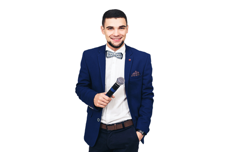 young stylish man with a microphone in his hand. isolated on white