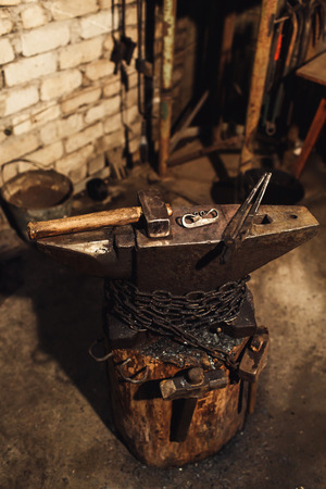 blacksmith workplace: anvil, hammers, blacksmith tongs, firesteel.