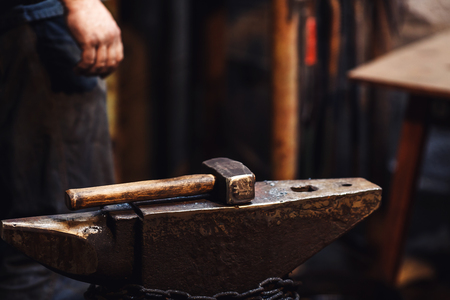 closeup of a blacksmiths hammer on the anvil