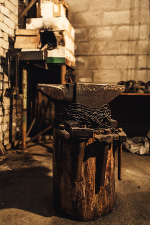 blacksmith workplace: anvil, hammers, furnace.