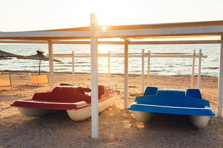 catamarans in sunlight on beach