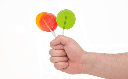 Lollipops in hand isolated on white background , good isolate