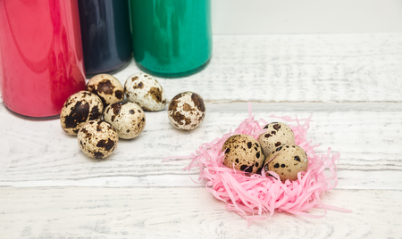 a box of quails eggs and paper butterflies, the concept of children and Easter Stock Photo