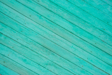 texture of green planks diagonally to the substrate , background