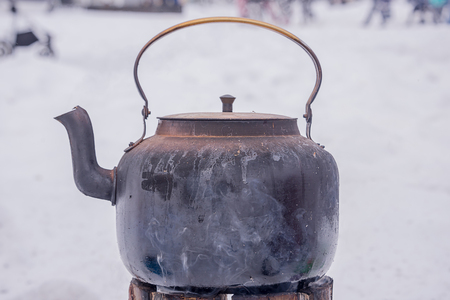 Kettle on the fire Russian samovar for tea, wood, street food