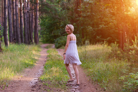 beautiful girl in the woods dancing and fooling around Stock Photo