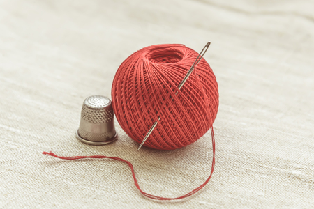 Composition of seamstress, tailor, thread for sewing and for knitting, red coil and needle