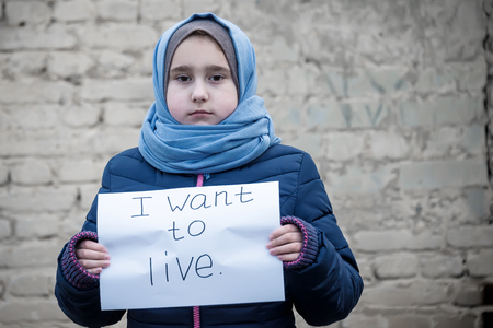 refugee girl with an inscription