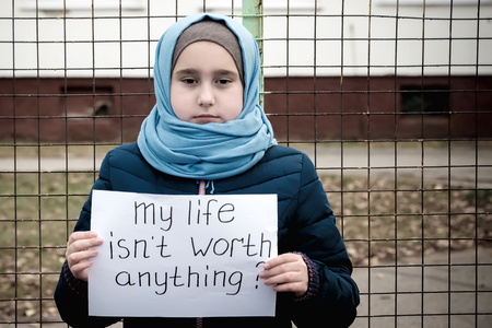 refugee girl with the inscription