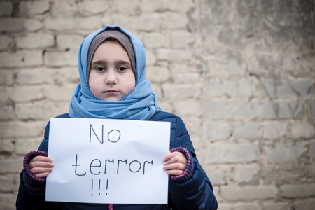 refugee girl with an inscription Archivio Fotografico