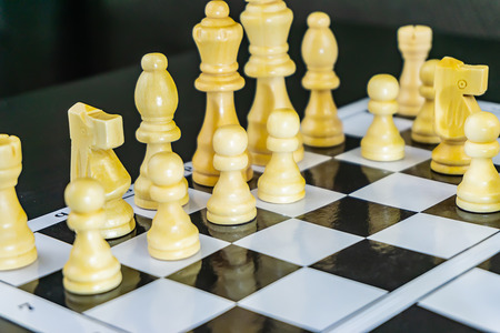 white and black chess on the chessboard playing a game