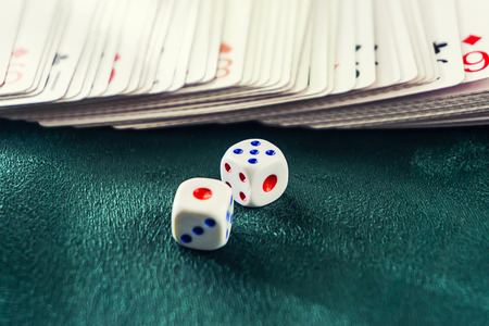 dice with poker cards on the table croupier before the distribution