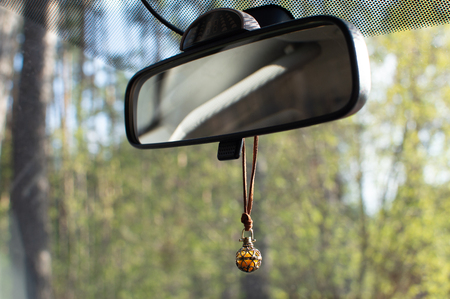 car mirror when riding in the forest in sunny weather Archivio Fotografico - 125132845