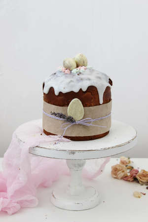 Cake with a sprig of lavender and white chocolate eggs. Symbol of the traditional Russian Orthodox Easter. Close up.
