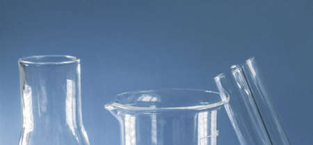 Laboratory. Glass test tubes on a blue background. Medical research. Close-up.