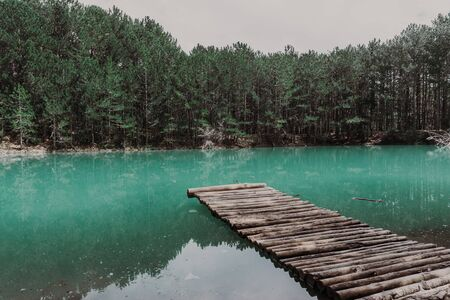 Beautiful turquoise lake in Crimea with the forest on the background