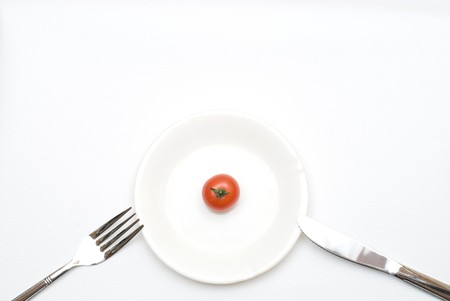 colord: Small Tomato on the plate