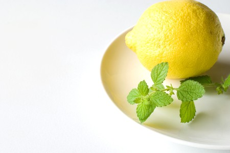 Lemon balm and Lemon on the plate photo