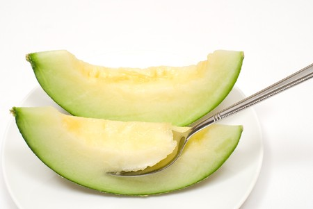 colord: Cut melon on a white background Stock Photo