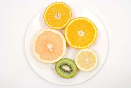 colord: Cut fruits on a white background