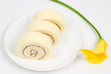 Swiss roll with Yellow calla lily photo