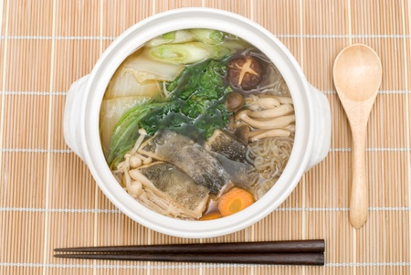 Codfish meat and vegetables served hot in a pot named Tara-Nabe photo